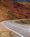 Curved road mountains narrow mountain asphalt with marking surrounded by rocks in the altai russia Stock Photo