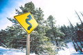 Curved road sign warning in colorado mountains united states Royalty Free Stock Photography