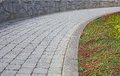 Curved stone path with wall Royalty Free Stock Photo