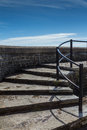 Curved stone steps leading up to wall and sky Royalty Free Stock Photo