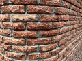 Curved red brick wall texture background