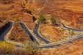 Curves winding road high view in red mountains Royalty Free Stock Photos