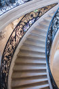 Curving circular staircase of the petit palais paris france portion with delicate ironwork railings marble stairs in Stock Photos