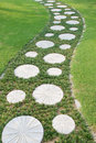Curving stepping stone path in the garden Royalty Free Stock Photo