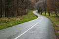Curvy asphalt road winding through countryside spring rain Stock Photography