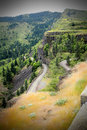 Curvy mountain road territorial view of a under dark skies in oregon Royalty Free Stock Photography
