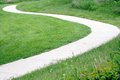 Curvy path clean on grass Stock Photo