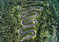 Curvy road from the high mountain pass in Transfagarasan, Romania. Royalty Free Stock Photo