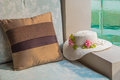 Cushion and hat at balcony poolside on summer Royalty Free Stock Image