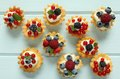 Custard tarts fresh delicious fruit with cream and berries Royalty Free Stock Photography
