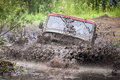 Custom built Off-road Trophy UAZ 469 in the swamp at high speed. Royalty Free Stock Photo