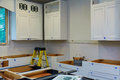 Custom kitchen cabinets in various stages of installation base for island in center Royalty Free Stock Photo