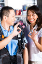 Customer buying equipment in divers shop Royalty Free Stock Photo