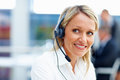 Customer care executive smiling at office Royalty Free Stock Photography