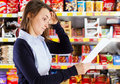 Customer looking at shopping list Royalty Free Stock Photo