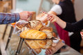 Customer paying for breads at bakery counter closeup of Royalty Free Stock Image