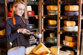 Customer paying for order of cheese in grocery shop. Royalty Free Stock Photo