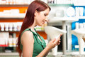 Customer in a pharmacy or drugstore shopping Royalty Free Stock Photo