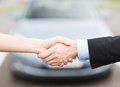 Customer and salesman shaking hands transportation business shopping ownership concept outside Royalty Free Stock Image