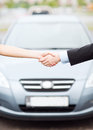 Customer and salesman shaking hands transportation business shopping ownership concept outside Royalty Free Stock Photo