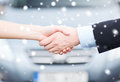 Customer and salesman shaking hands transportation business shopping ownership concept outside Stock Image