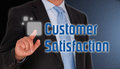 Customer satisfaction businessman touching button in interactive screen Stock Image