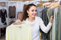 Customer selecting basic garments brunette happy at the store Royalty Free Stock Photo