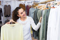 Customer selecting basic garments young female at the store Royalty Free Stock Photo