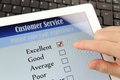 Customer service online survey satisfaction on a digital tablet Royalty Free Stock Photography