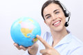 Customer service operator woman with headset smiling globe holding contact us concept Stock Images
