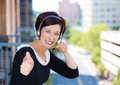 Customer service representative, call center agent, support staff or operator with headset on outside balcony Royalty Free Stock Photo