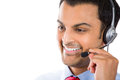 Customer service representative closeup portrait of male or call centre worker or operator or support staff speaking with head set Stock Photo