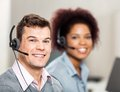 Customer service representative with colleague portrait of smiling male female working in office Stock Photo
