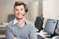 Customer service representative with headset in portrait of confident male call center Stock Photo