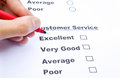 Customer service survey form and pen tick in box Stock Photography