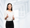 A customer support operator holding thumbs up young confident and smiling working in office Stock Photos