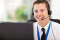 Customer support operator smiling male with headset Royalty Free Stock Photos