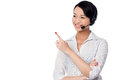 Customer support staff pointing away young towards copy space area Stock Image