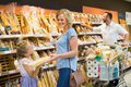 Customers in bread section in food store Royalty Free Stock Photo