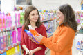 Customers choosing cleaning products in supermarket Royalty Free Stock Photo
