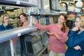 Customers choosing mirrow in warehouse store Royalty Free Stock Photo