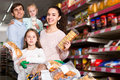 Customers with small children purchasing shortcakes Royalty Free Stock Photo