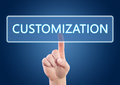 Customization hand pressing button on interface with blue background Stock Photography