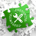 Customize concept on green puzzle pieces written arround icon of crossed screwdriver and wrench service Royalty Free Stock Image