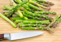 Cut asparagus on cutting board with knife Royalty Free Stock Photo