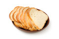 Cut bread on plate Royalty Free Stock Images