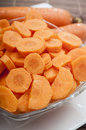 Cut carrot in bowl close up Stock Photos