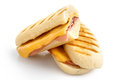 Cut cheese and ham toasted panini melt. Isolated on white. Royalty Free Stock Photo