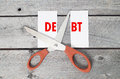 Cut debts concept against a wooden background Royalty Free Stock Images