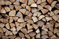 Cut firewood stack logs as pattern Royalty Free Stock Photo